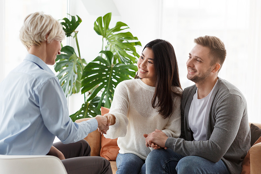 therapist sitting with laughing woman